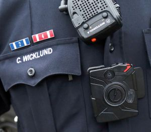 Sgt. Chris Wicklund of the Burnsville Police Department wears a body camera beneath his microphone. Minneapolis, with the largest police department in Minnesota, has become the latest to equip officers with body cameras in what officials say is an effort to improve transparency and police accountability (AP Photo/Jim Mone)
